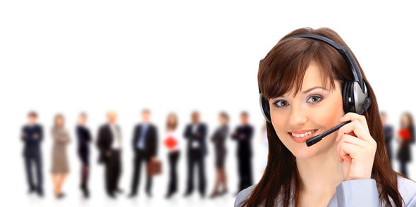 Call center operator with headset and business team
